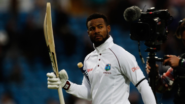 Shai Hope walks back after the win