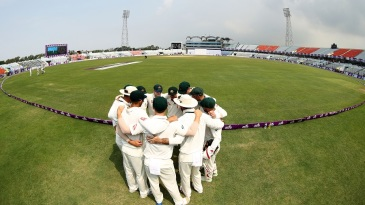 Australia's players gather into a huddle before walking out to the field