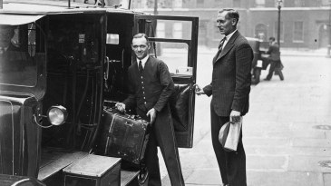 Hedley Verity (right) has his bags loaded into a taxi