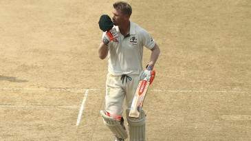 David Warner kisses his cap after completing his century