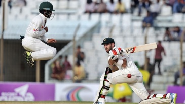 Mominul Haque leaps to evade a sweep from Glenn Maxwell