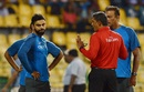 Umpire Ruchira Palliyaguruge in conversation with Virat Kohli during a rain delay, Sri Lanka v India, Only T20I, Colombo, September 6, 2017