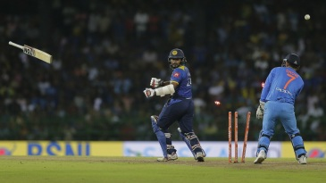 Dilshan Munaweera loses his bat, and his off stump