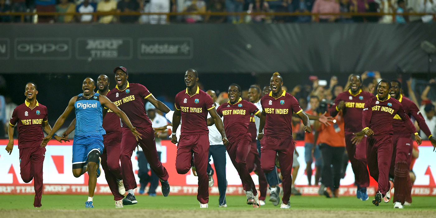 West Indies players run on to the field after Carlos Brathwaite sealed the win