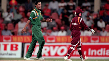 Wasim Akram laughs after the fall of a West Indies wicket