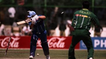 Darren Gough is bowled by Wasim Akram