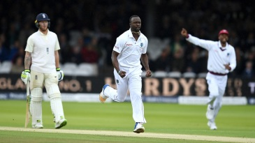 Kemar Roach celebrates after dismissing Dawid Malan