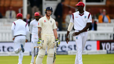 Ben Stokes and Jason Holder share a joke during a hard-fought passage of play