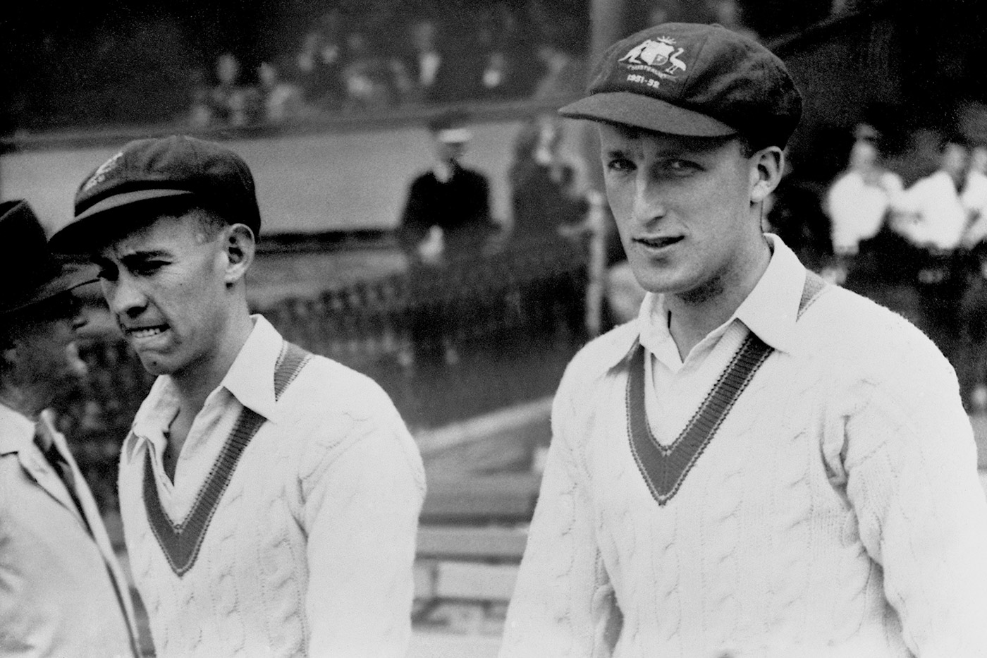 Archer (left) walks out with Graeme Hole in the Sydney Test against West Indies in 1951