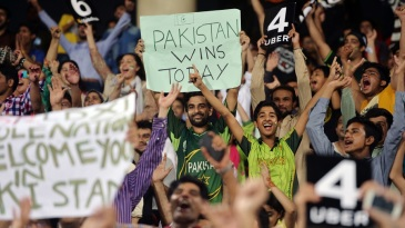 Pakistan fans celebrate cricket's return to the country