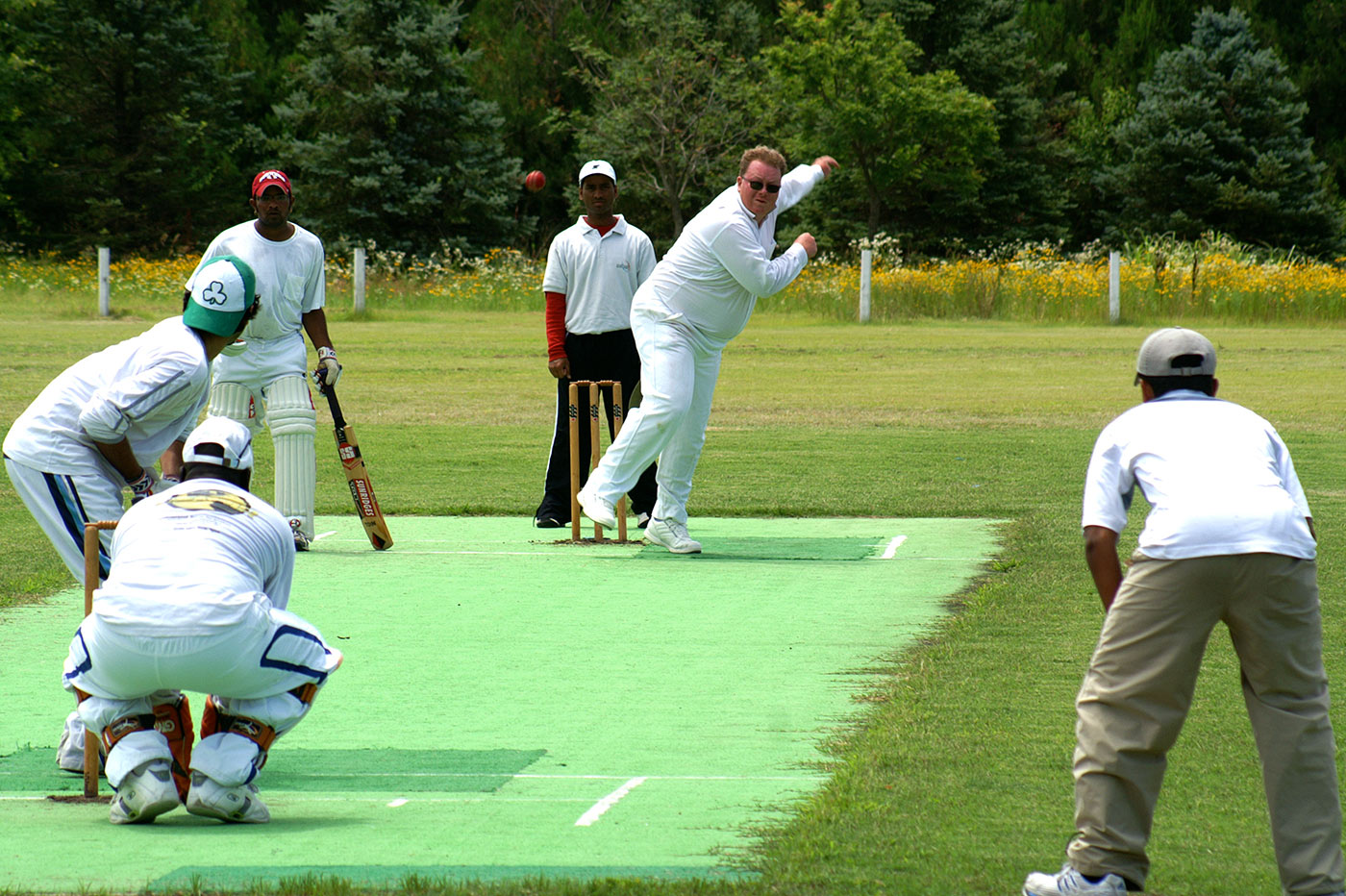 Edward Fox bowls on the cricket ground he built