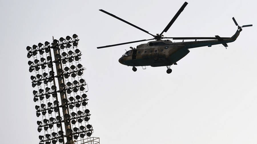 A Pakistani army helicopter patrols over the Gaddafi Stadium