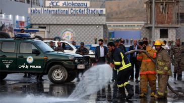 Firefighters in action outside Alokozay Kabul International Cricket Stadium