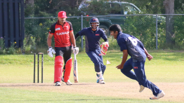 Nosthush Kenjige sprints away after bowling Rizwan Cheema to complete a hat-trick