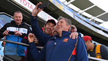 Essex coach Chris Silverwood poses with fans for a selfie