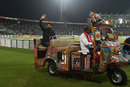 Former Pakistan captain Misbah-ul-Haq rides on an auto-rickshaw as he waves to the crowd, Pakistan v World XI, 3rd T20I, Lahore, September 15, 2017