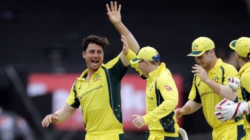 Marcus Stoinis celebrates after getting Rohit Sharma's wicket