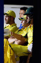 Glenn Maxwell, Steven Smith and Pat Cummins watch from the pavilion, India v Australia, 1st ODI, Chennai, September 17, 2017