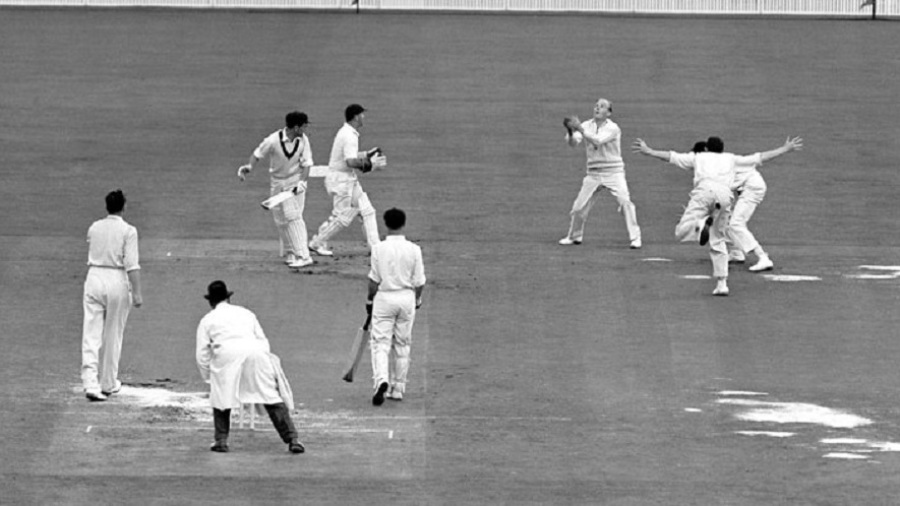 Tony Lock takes a catch off Jim Laker in the Test in which they took all 20 Australian wickets between them