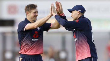 Chris Woakes gets a high five from Joe Root