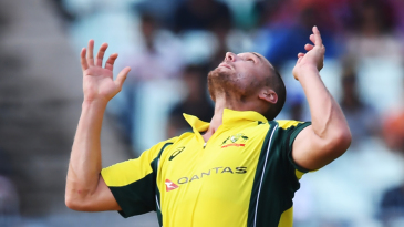 Nathan Coulter-Nile keeps his eye on the ball wile juggling a return catch from Rohit Sharma