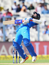 Ajinkya Rahane gets out of the line of a Pat Cummins bouncer just in time, India v Australia, 2nd ODI, Kolkata, September 21, 2017