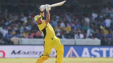 Aaron Finch launches a six down the ground