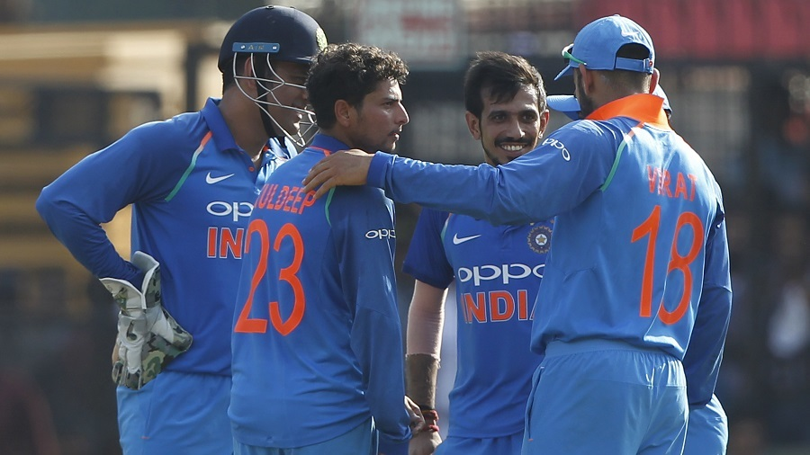 Kuldeep Yadav is mobbed by his team-mates