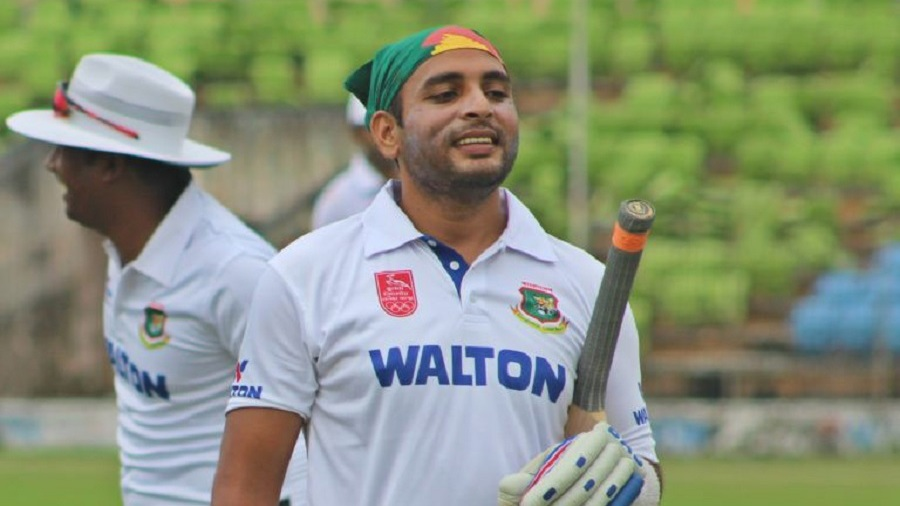 Tushar Imran walks off after hitting a century