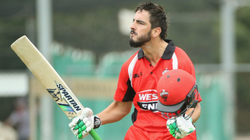Cameron Valente exults after getting to his century off 138 balls while batting at No. 7