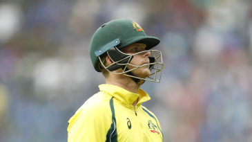 Steven Smith walks back after being dismissed early