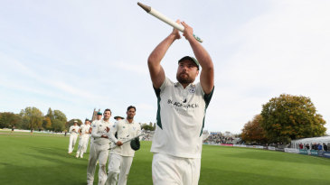 Joe Leach leads his team off after securing victory