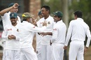 Mustafizur Rahman is mobbed by his team-mates, South Africa v Bangladesh, 1st Test, Potchefstroom, 2nd day, September 29, 2017