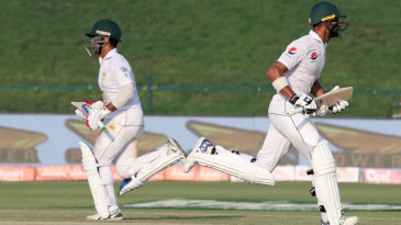 Sami Aslam and Shan Masood run between the wickets