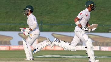 Sami Aslam and Shan Masood run between the wickets