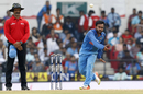 Kedar Jadhav lets one rip with his low-arm release, India v Australia, 5th ODI, Nagpur, October 1, 2017
