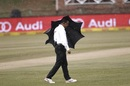 Umpire Shaun George takes shelter from rain, South Africa v Bangladesh, 1st Test, Potchefstroom, 4th day, October 1, 2017