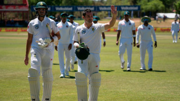 Aiden Markram and Dean Elgar walk off after a session