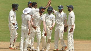 R Ashwin celebrates with team-mates
