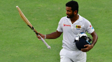 Dimuth Karunaratne soaks in the applause as he walks off for 196