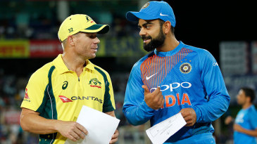 Virat Kohli chats with Australia's stand-in captain David Warner