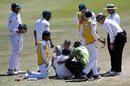 South Africa's team doctor Mohammed Moosajee attends to Mushfiqur Rahim after he is hit on the head, South Africa v Bangladesh, 1st Test, Bloemfontein, 3rd day, October 8, 2017