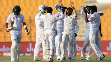 Sri Lanka players celebrate the wicket of Babar Azam