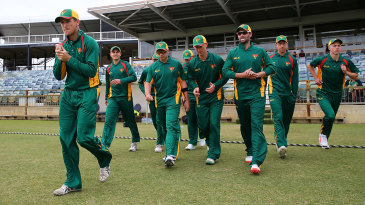 Tasmania captain George Bailey leads his players onto the field