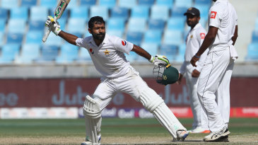 Asad Shafiq celebrates his century