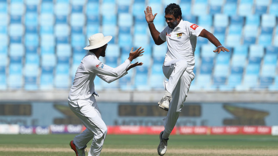Dilruwan Perera takes off in celebration after taking a wicket