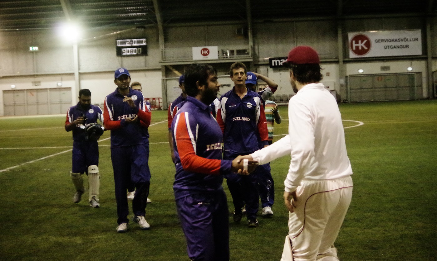 Charlie Campbell shakes hands with Iceland's Abhishek Chauhan. Also visible in the photo are home side's  Chamley Fernando (keeper), Leslie Dcunha (clapping) and Lee Nelson