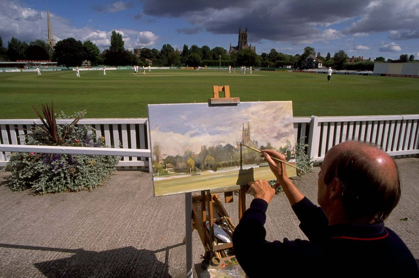 A painter captures the scene on the first day of the final Test, in Worcester