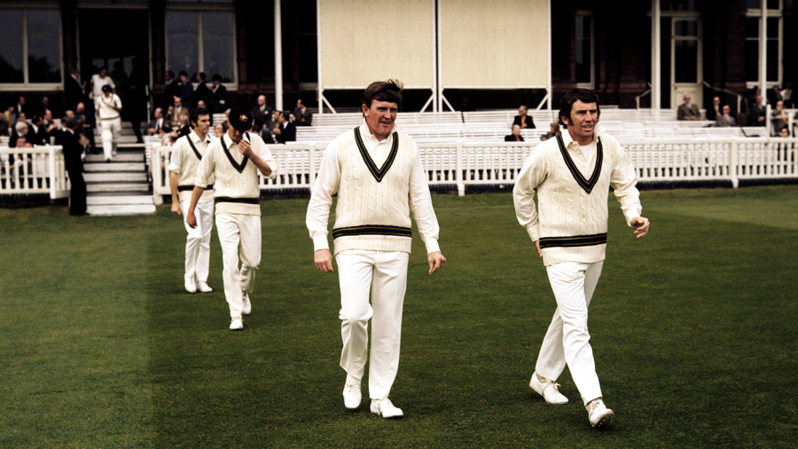 Ian Chappell leads his team out