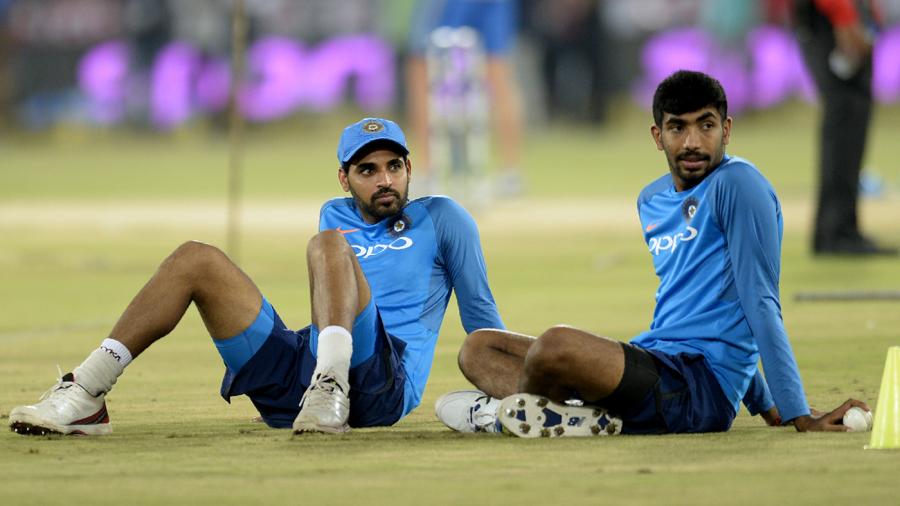 Bhuvneshwar Kumar and Jasprit Bumrah wait for proceedings to begin